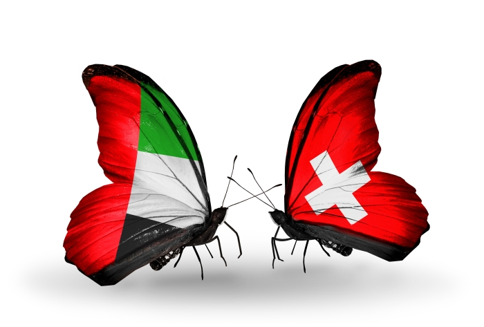 Two butterflies with flags on wings as symbol of relations UAE and Switzerland